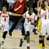 Victory! - Louisville players celebrate after defeating Michigan, 82-76, in the NCAA Men's Basketball Championship at the Georgia Dome in Atlanta, Georgia,...
