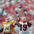 Tough D - A Tennessee defensive back tries to break up a pass to a Georgia receiver during a game in Athens, GA.