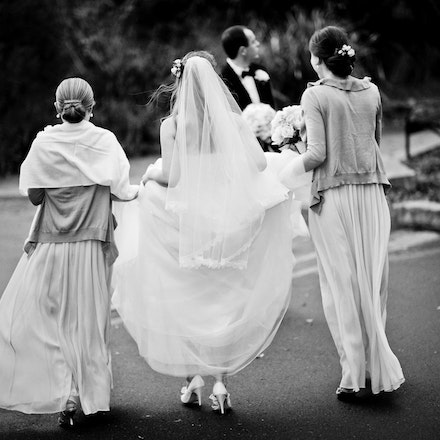 012 | Candid shot of bride and bridesmaids walking between location shoots at the Tea Room in Mosman - Copyright © 2015 Melissa Fiene Photography. All...