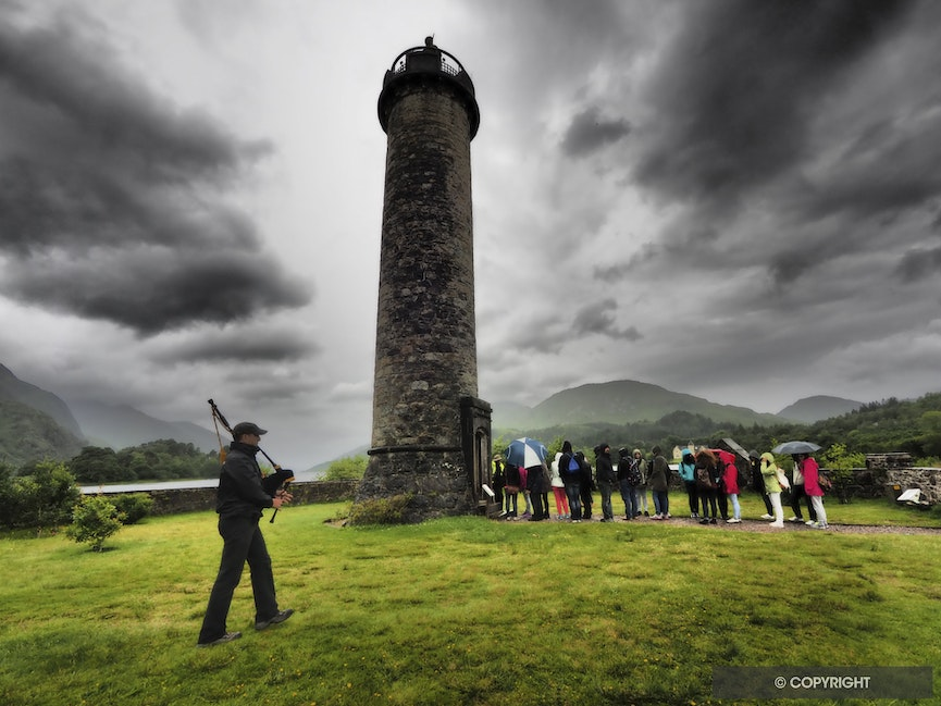 Glenfinnan Piper - A piper sets the mood at the monument depicting the site of Bonnie Prince Charles 1745 return to Scotland with tunes from Star Wars