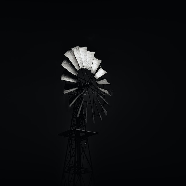 The Mill - A classic Aussie country windmill, bathed in afternoon light.