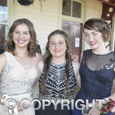 161118_SR24928 - Crystal Bigby, Maddy Hayward and Lily Smith at the Longreach State High School's Year 12 Formal photo call at the Railway Station, Friday...