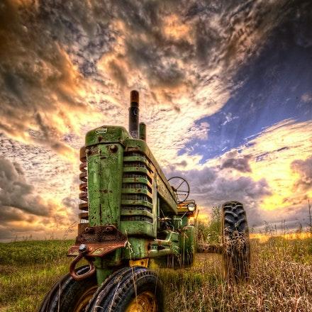 Impressive  Front 9.7.2016.7 - Impressive Front. Prairie grass grows tall around an old giant in Lancaster County, NE. #nebraska #farm #sunset #farmsunset...