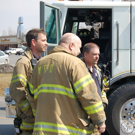 On Scene Conference - Martinsburg, WV, USA, March 22, 2007: Fire and Police Department personnel confer at the scene.